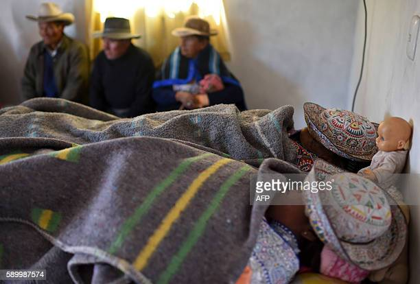 The bodies of a local woman and her eightyearold granddaughter are laid together before burial in the Andean town of Yanque on August 15 after they...