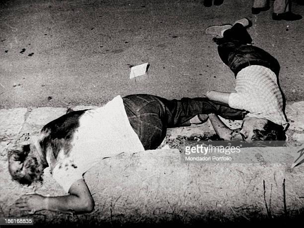 The bodies of Carabinieri lieutenantcolonel Giuseppe Russo and his friend Filippo Costa lying dead The men were killed during a Mafia attack...