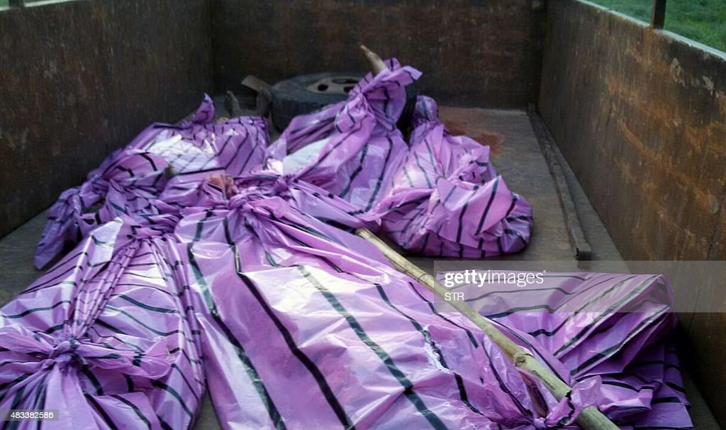 The bodies of five women killed by villagers who accused them of practicing witchcraft lay in plastic bags in Kanjia village in eastern Jharkhand...