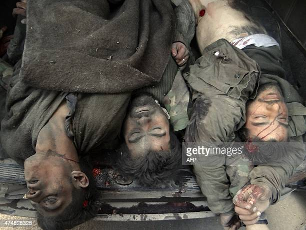 CONTENT The bodies of men allegedly belonging to a progovernment militia are seen lying in the back of a truck in the village of Aziza south of the...