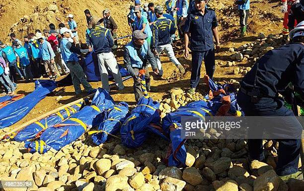The bodies of miners killed by a landslide are placed on the ground in a jade mining area in Hpakhant in Myanmar's Kachin state on November 22 2015...