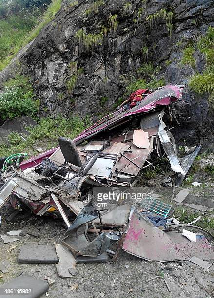 the bodies of passengers lie amidst the mangled remains of a private bus which skidded off the road at Nathpa in Kinnaur district some 175 kms from...