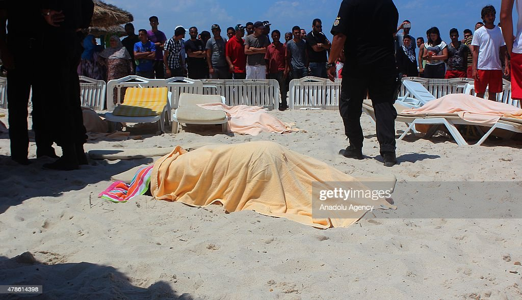 The bodies of people are seen after an armed attack on a tourist hotel in Sousse, east Tunisia, left at least 27 people dead, including foreigners, and injured six others , on June 26, 2015.