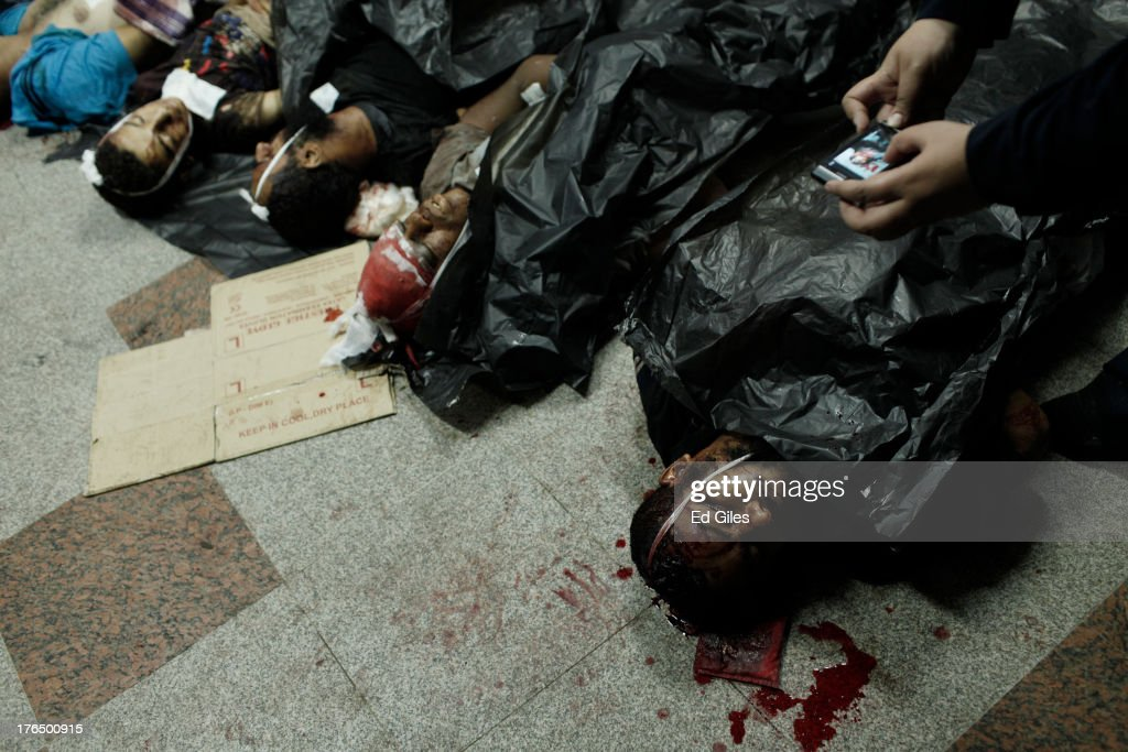 The bodies of supporters of deposed Egyptian President Mohammed Morsi lie on the floor of the Rabaa al-Adaweya Medical Centre in the Nasr City district on August 14, 2013 in Cairo, Egypt. An unknown number of pro-Morsi protesters were killed in Egypt's capital today as Egyptian Security Forces undertook a planned operation to clear Morsi supporters from two sit-in demonstrations in Cairo where they have camped for over one month. Egyptian Police and Army forces entered protest sites in the Nasr City and Giza districts at dawn using tear gas, live fire and bulldozers to disperse protesters and destroy the camps. A state of emergency has been declared in Egypt to begin this afternoon and will reportedly last for one month.