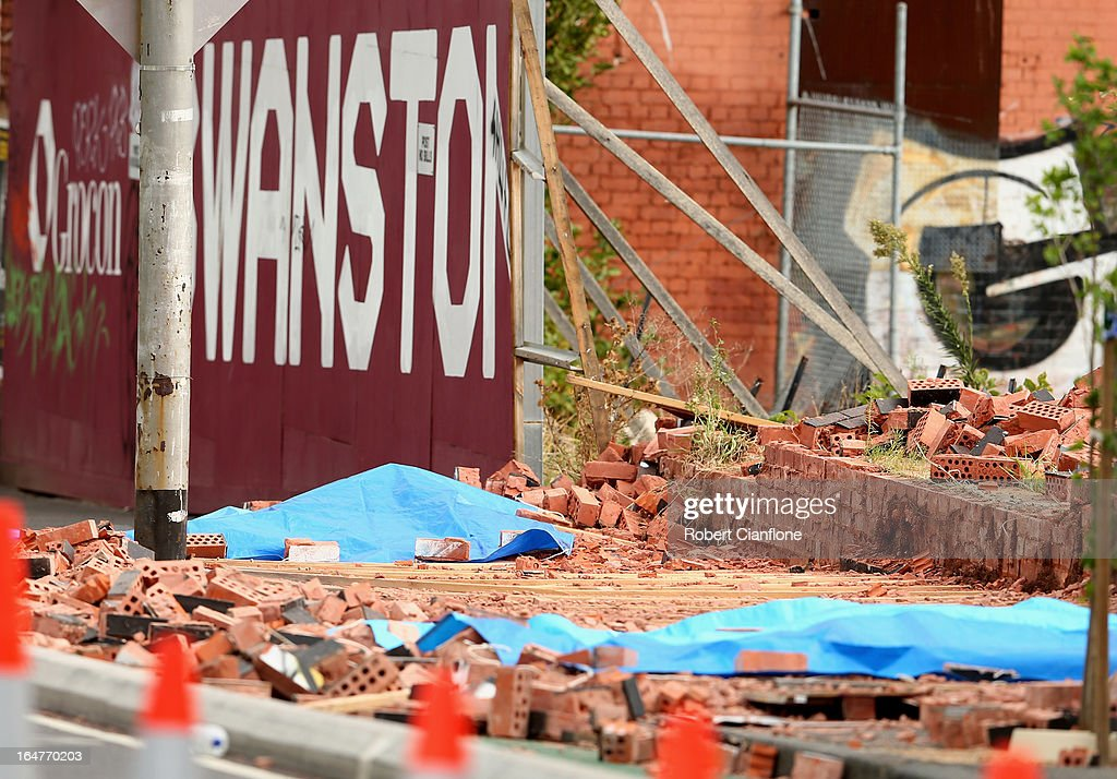 The bodies of the deceased are covered up after a wall collapse on March 28, 2013 in Melbourne, Australia. Police have confirmed two people have died and another has been seriously injured after a brick wall collapsed on Swanston street in Carlton in North Melbourne CBD.