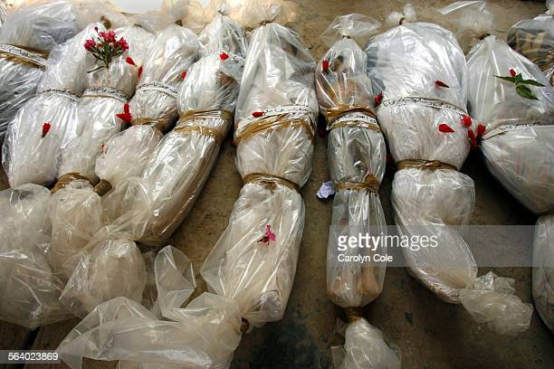 QANA LEBANON – The bodies of those killed in the Qana overnight bombing are laid out at the government hospital before being placed in the morqueMore...