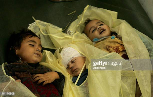The bodies of three Palestinian siblings from the Alsamoni family killed by an Israeli tank shell early on January 5 2009 lie in the mortuary of...