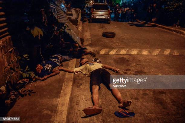 The bodies of two men lie dead on the street after they were killed by police in what they say was an antiillegal drugs operation in Manila...