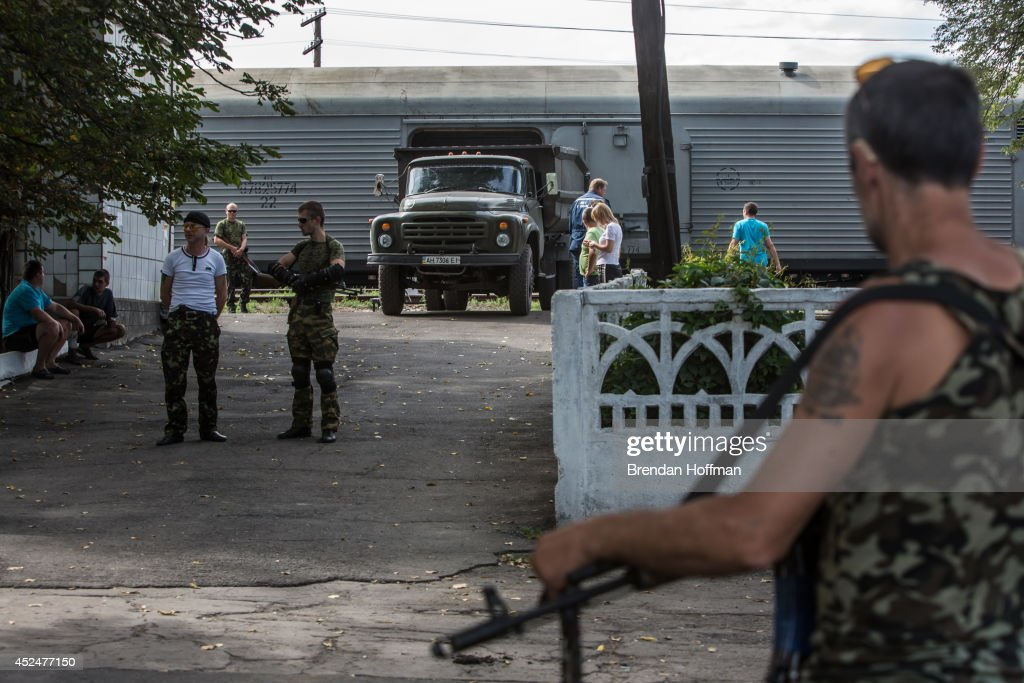 The bodies of victims of the crash of Malaysia Airlines flight MH17 arrive at the Torez train station in the back of a truck to be loaded into a refrigerated train car on July 21, 2014 in Torez, Ukraine. Malaysia Airlines flight MH17 was travelling from Amsterdam to Kuala Lumpur when it crashed killing all 298 on board including 80 children. The aircraft was allegedly shot down by a missile and investigations continue over the perpetrators of the attack.