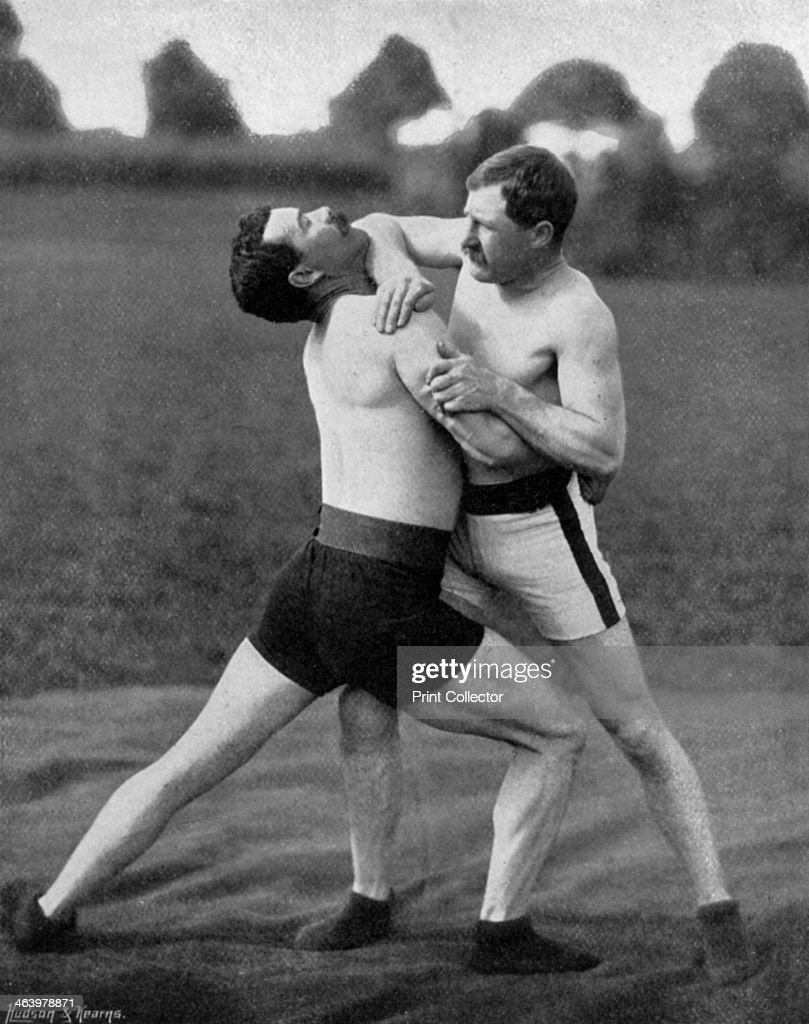 The body holt and neck double, wrestling display, Aldershot, Hampshire, 1896. A print from The Navy and Army Illustrated, 30th October 1896.