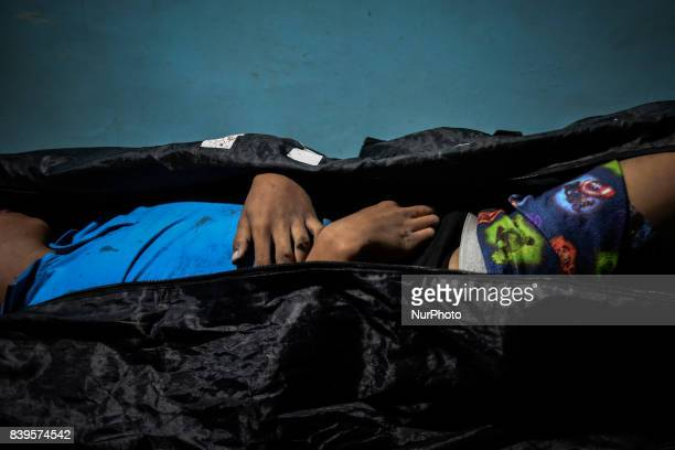 The body of 17 year old Kian Loyd Delos Santos lies inside a morgue in Malabon Metro Manila Philippines August 16 2017 Amidst the drug crackdown's...