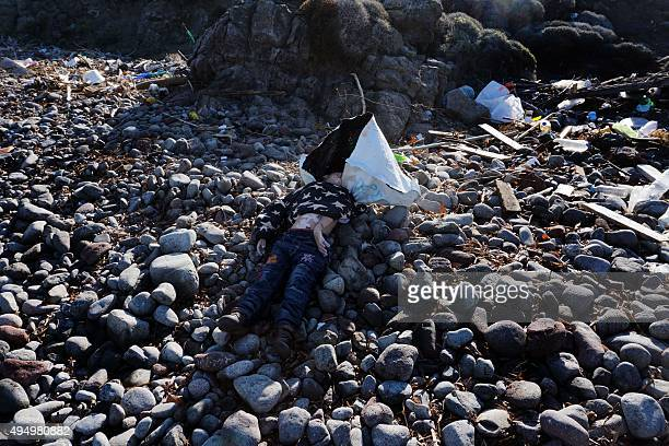 The body of a child lies on a beach on the Greek island of Lesbos on October 30 after boats transporting migrants and refugees trying to cross the...