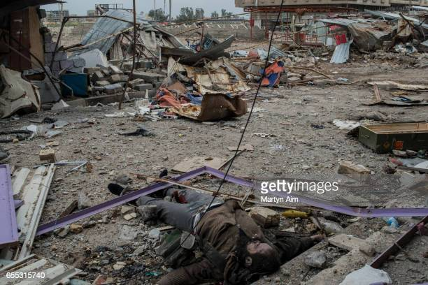 The body of a dead Islamic State fighter killed by Iraqi forces lays in a destroyed street in Bab alTob a neighbourhood in the Old City of west Mosul...