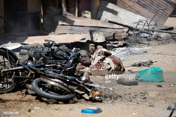 The body of a Malian rebel fighter is pictured after clashes erupted in the city of Gao on February 21 2013 and an apparent car bomb struck near a...