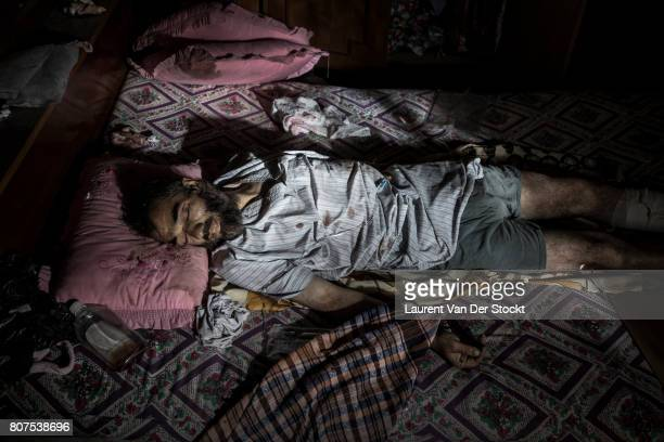 The body of a man found dead in a room in alNuri mosque complex on June 29 in Mosul Iraq The man's neighbor said he died of wounds sustained in a...