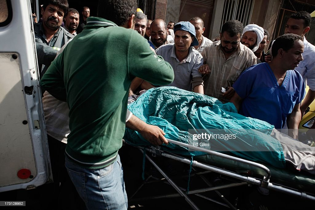 The body of a man is carried on a stretcher at the Liltaqmeen al-Sahy Hospital in Cairo's Nasr City district, after allegedly being killed during a shooting at the site of a pro-Morsi sit-in in front of the headquarters of the Egyptian Republican Guard on July 8, 2013 in Cairo, Egypt. Egyptian health ministry officials are reporting at least 42 people were killed and more than 300 injured in the incident early on Monday morning, which allegedly occurred as supporters of deposed Egyptian President Mohammed Morsi attending the sit in were performing dawn prayer. The demonstrators were demanding the release of Morsi, who they believe is being held inside the Republican Guard headquarters.