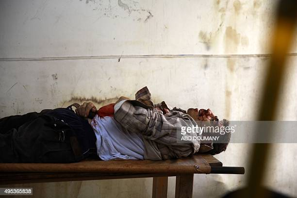 The body of a man is seen inside a morgue following a reported airstrike by Syrian government forces on the rebelheld town of Douma on the eastern...