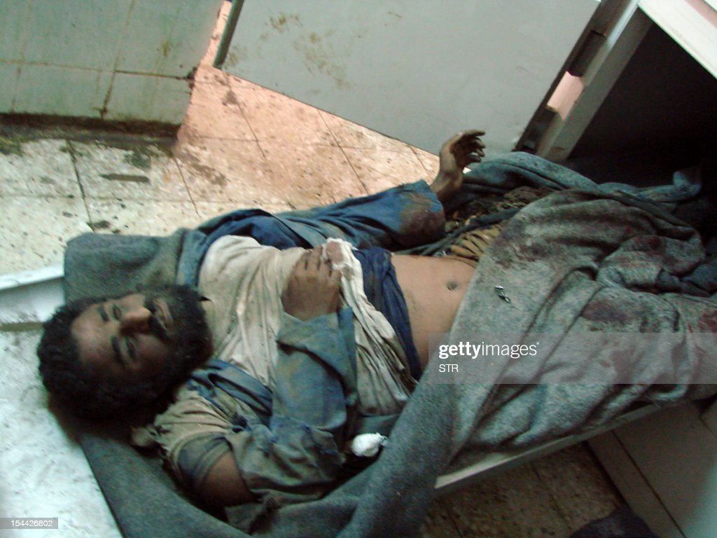 The body of a man lies at the mortuary of a hospital in the southern town of Shaqra, 35 kms (22 miles) from Abyan's capital Zinjibar, on October 19, 2012 after Al-Qaeda militants set off an explosives-laden car inside an army base in southern Yemen at dawn, killing at least 15 soldiers and wounding 29 others, military officials said.