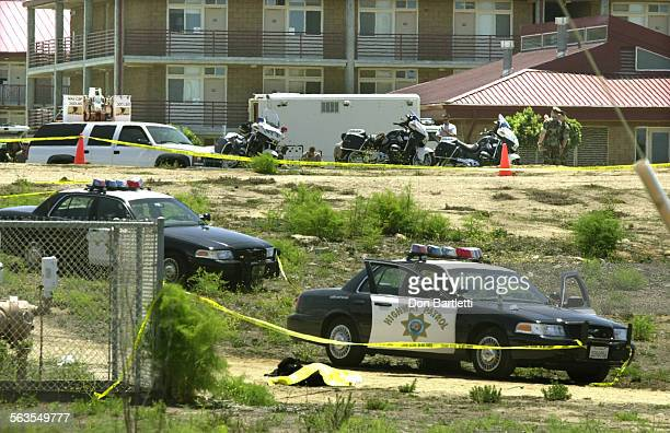 The body of a man lies beneath a yellow tarp near Marine barracks on Camp Del Mar in Oceanside At about 8am for unknown reasons the man shot and...