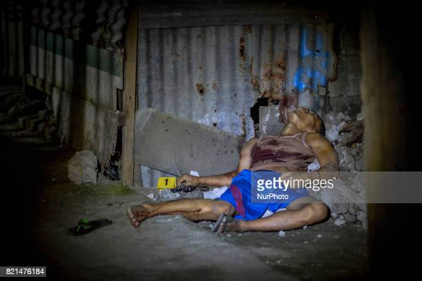 The body of a man lies dead next to a revolver after he was killed in a shootout with police in Caloocan Metro Manila Philippines July 20 2017 The...