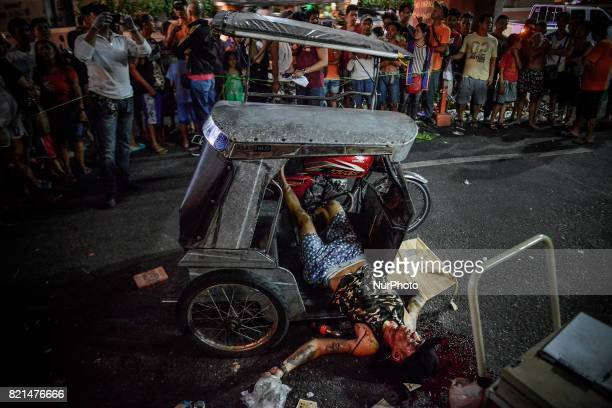 The body of a man lies on a tricycle after he was killed by unknown assailants in Manila Philippines July 17 2017 The United States congress is the...