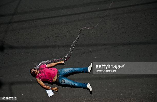 The body of a man shot dead during a robbery lies on the street in San Salvador on August 22 2014 More than 152 homicides have been registered so far...