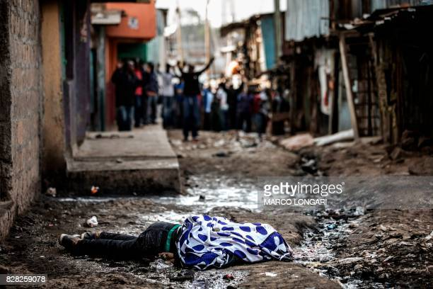 The body of a man shot in the head allegedly by Kenyan police lies in an alley of Mathare slum in Nairobi on August 9 as unrest broke out a day after...