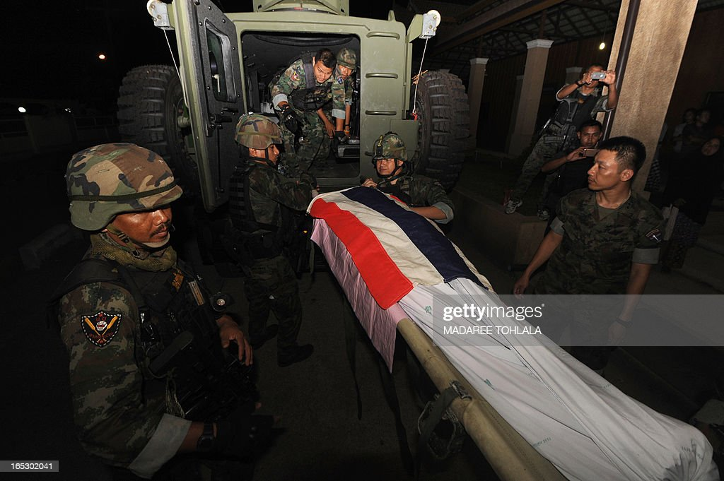 The body of a Muslim soldier who was killed by suspected separatist militants lies on a stretcher at a hospital in Thailand's restive southern province of Narathiwat on April 2, 2013. Muslim Thai private marine who was abducted from his house two days ago, was found shot dead in appraently retaliation by militants from their massive loss last month, Thai army said. AFP PHOTO / Madree Tohlala