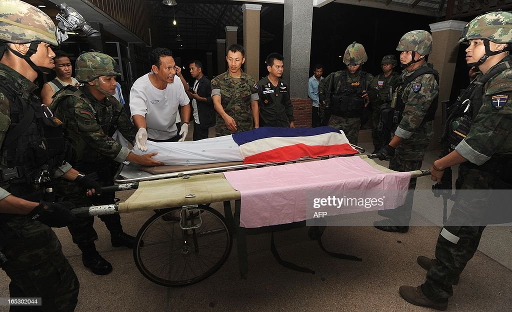 The body of a Muslim soldier who was killed by suspected separatist militants lies on a stretcher at a hospital in Thailand's restive southern province of Narathiwat on April 2, 2013. Muslim Thai private marine who was abducted from his house two days ago, was found shot dead in appraently retaliation by militants from their massive loss last month, Thai army said. AFP PHOTO / Ye Aung Thu