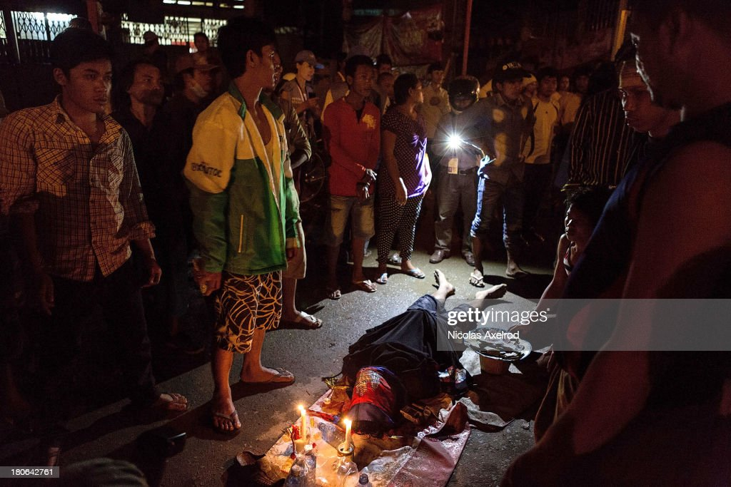 The body of a protestor who died after being allegedly shot by anti-riot police lays on the road, clashes erupted near Monivong bridge South of Phnom Penh on September 15, 2013 in Phnom Penh, Cambodia. The CNRP plan a three day demonstration to contest the Cambodian national election results.