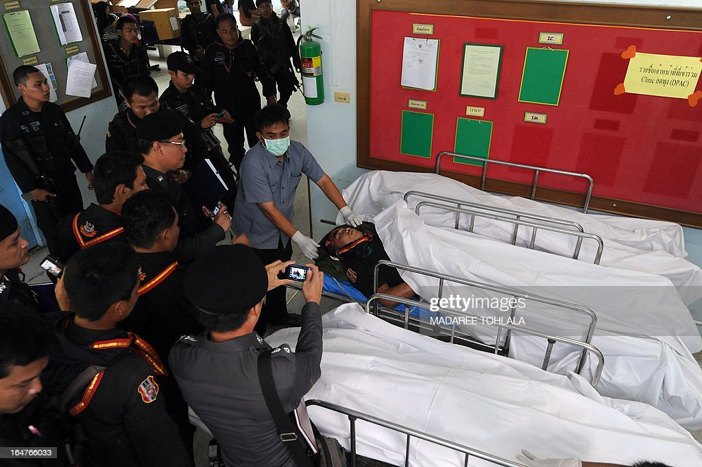 The body of a Ranger who was killed in a roadside bomb attack by suspected separatist militants lies on a stretcher at a hospital in Thailand's restive southern province of Narathiwat on March 28, 2013. Thailand opened its first formal peace talks with a rebel group from its insurgency-wracked south on March 28, as a fresh bombing killed three people in a stark reminder of the difficulties negotiators face. AFP PHOTO/Madaree TOHLALA