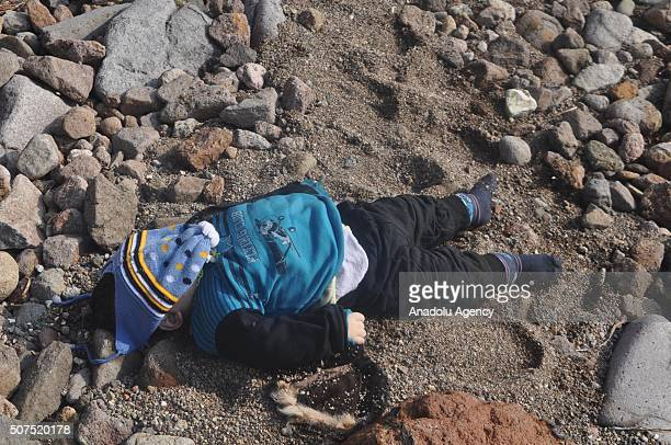 The body of a refugee baby is seen on a beach after a boat carrying refugees sank off close to coast of Ayvacik district Canakkale Turkey on January...