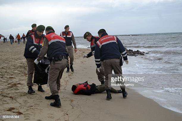 The body of a refugee is washed ashore on a beach in Ayvalik district of Balikesir after a boat carrying refugees sank off during their journey to...