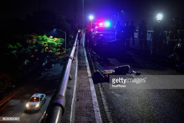 The body of a shooting victim lies dead along a bridge in Manila Philippines June 6 2017 Drugrelated killings continue as President Rodrigo Duterte...