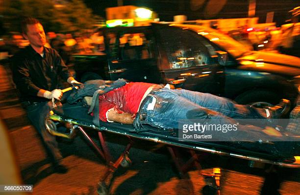 CULIACAN SINALOA MEXICO NOV 20 2008 The body of a Sinaloa state police officer is wheeled away from the pickup in which he and 4 other policemen were...