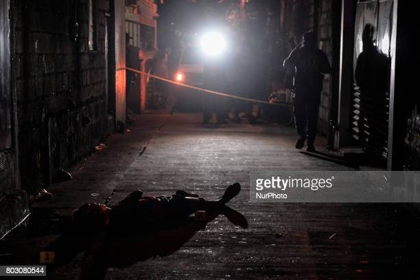 The body of a suspected drug user lies in an alley after he was shot dead by unknown assailants in Navotas north of Manila Philippines June 19 2017...