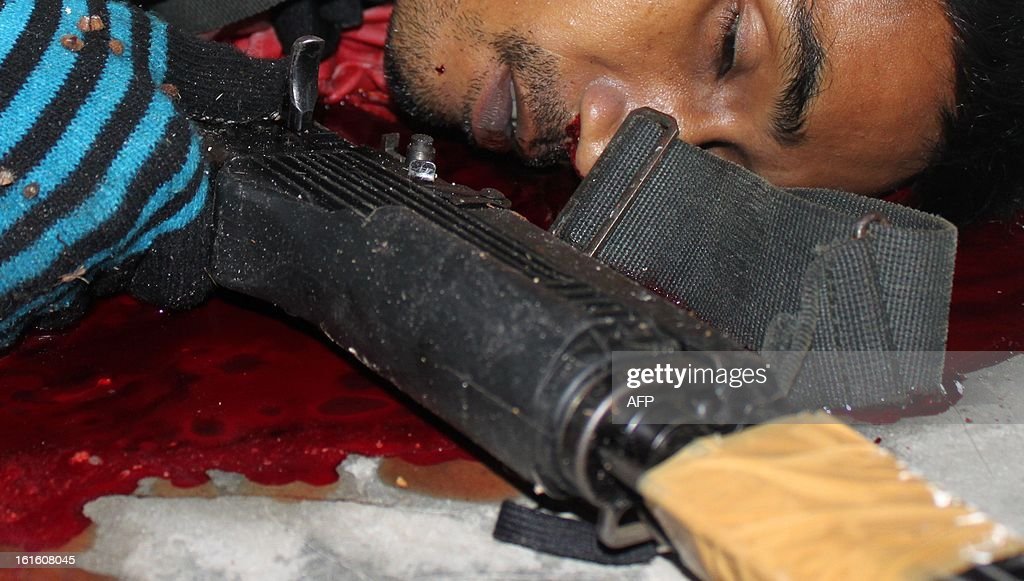 The body of a suspected insurgent who was killed when he attacked a military base in Thailand's restive southern province of Narathiwat on February, 13, 2013. Scores of heavily armed gunmen stormed a military base in unrest-plagued southern Thailand, an army spokesman said, in a major assault that left at least 16 militants dead.