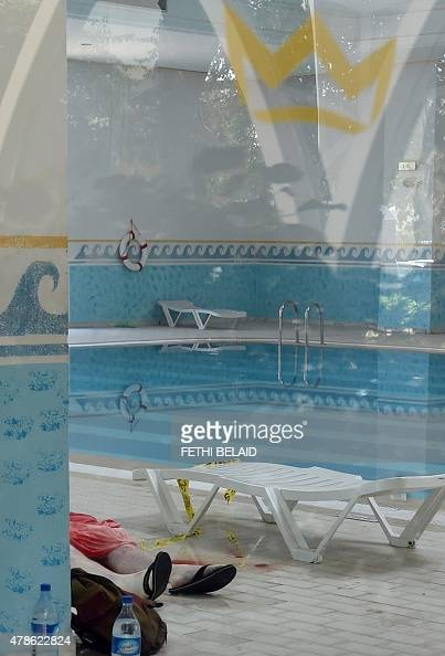 The body of a tourist is seen at the Imperial hotel in the resort town of Sousse a popular tourist destination 140 kilometres south of the Tunisian...