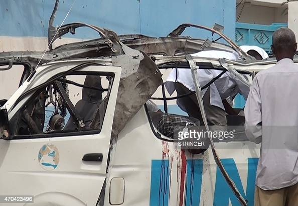 The body of a victim is seen in the shell of a UN van following a bomb attack that killed at least six UN workers on April 20 2015 in the...