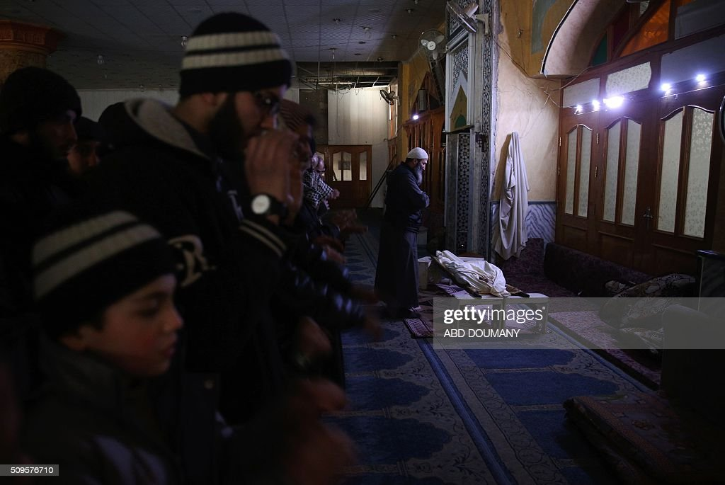 The body of Abdulrahman, a 17-year-old Syrian youth who worked with a civil defense group and was killed by a mortar shell attack earlier in the day, is seen at a mosque during his funeral in the rebel-held city of Douma, northeast of the capital Damascus, on February 11, 2016. / AFP / Abd Doumany