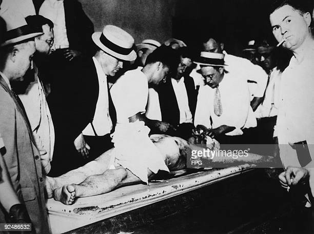 The body of American bank robber John Dillinger is displayed to the public at the Cook County morgue Illinois July 1934 He was shot by federal agents...