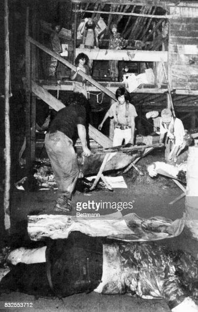 The body of American journalist Linda Frazier lies in foreground as Nicaraguan guerrillas help others wounded by the explosion at a news conference...