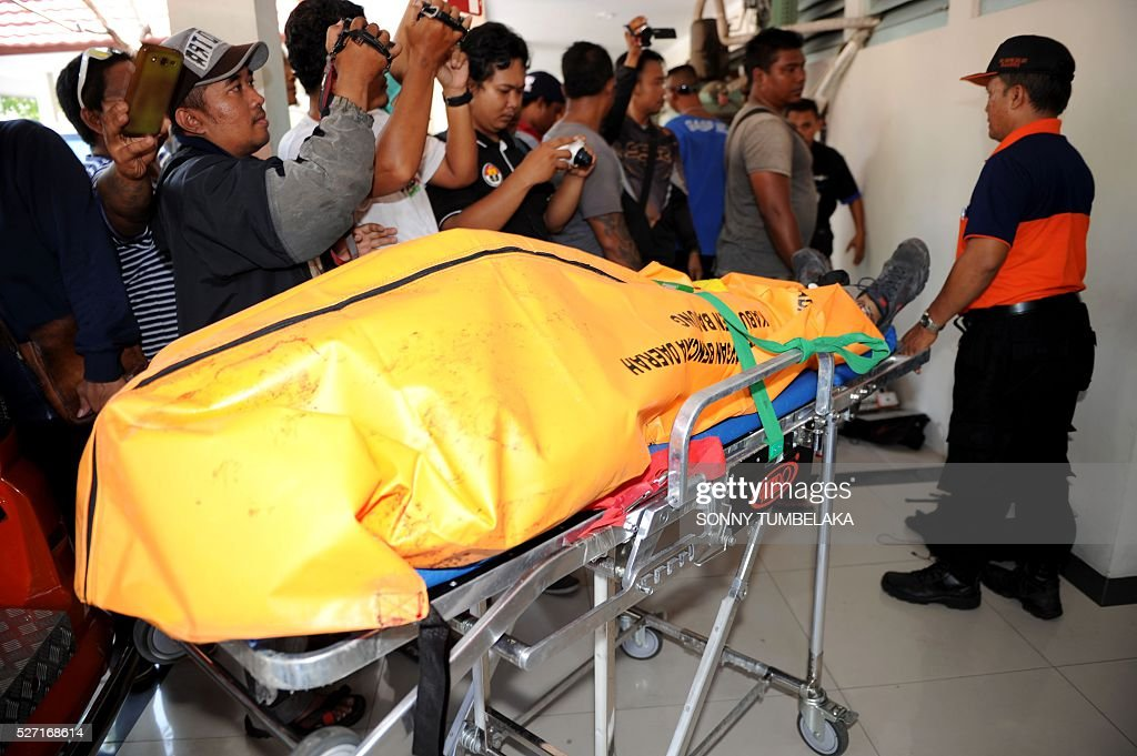 The body of Amokrane Sabet from France arrives at Sanglah hospital in Denpasar, on Bali island on May 2, 2016. Police shot dead the French wrestler after he killed a policeman as authorities sought to arrest him for immigration violations, an official said. Sabet, 49, had become known as troublemaker in the area around south Bali where he lived and was the subject of numerous complaints from villagers, police said. TUMBELAKA