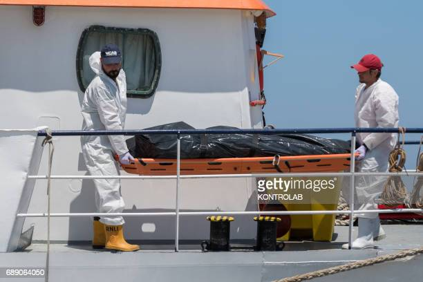 The body of an adult dead at sea transported during the phase of landing migrants from Phoenix MOAS ship in the port of Crotone Calabria southern...