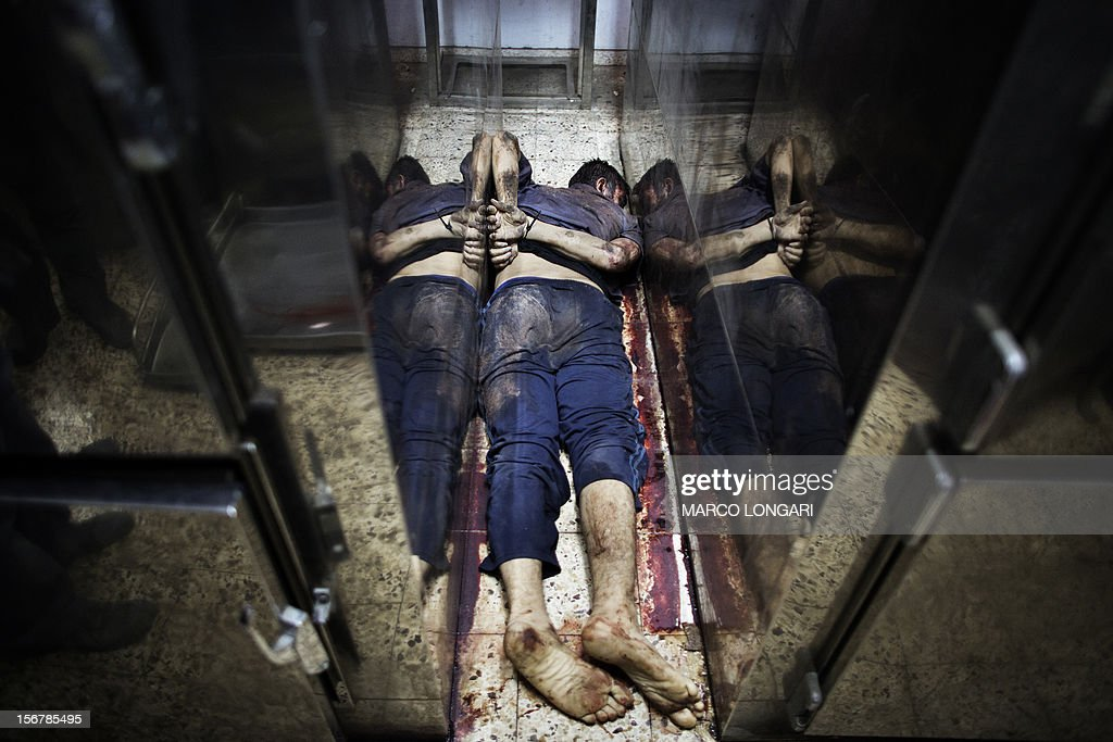 The body of an alleged collaborator lies in between fridges inside a hospital's morgue in Gaza City November 21, 2012. Gunmen executed six 'collaborators' in Gaza City , witnesses told AFP on November 20, adding that notices were pinned to their bodies saying they had been killed by Hamas's armed wing.