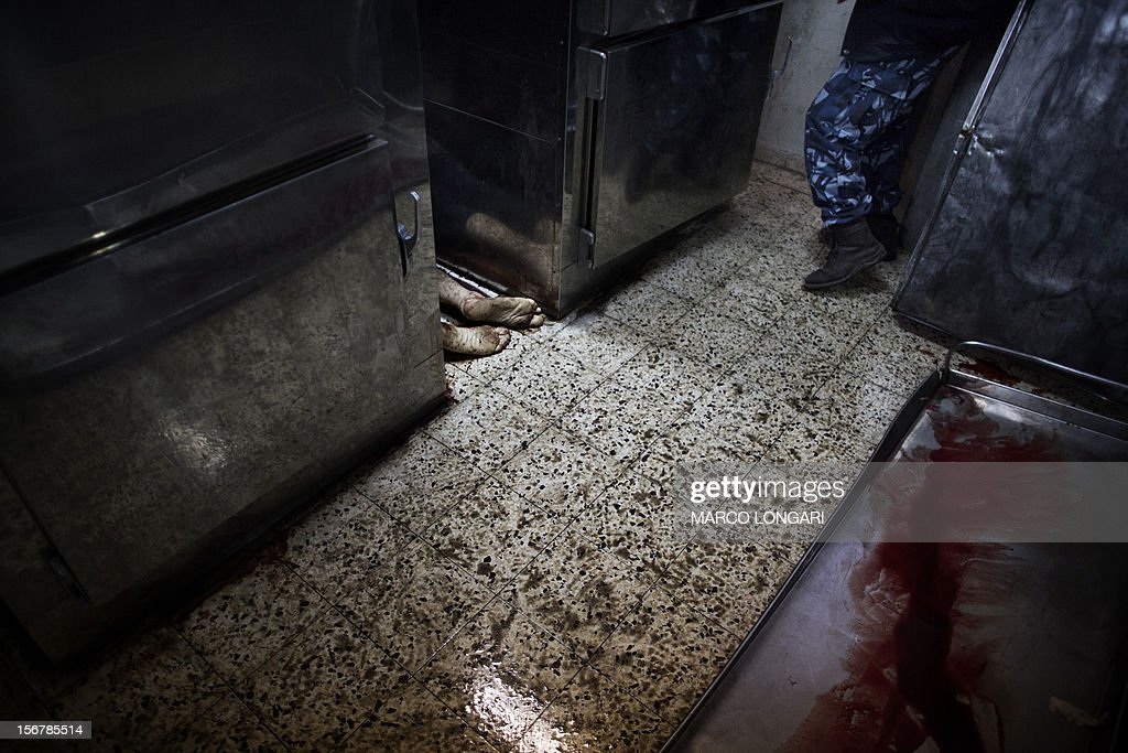The body of an alleged collaborator (L) lies in between fridges inside a hospital's morgue in Gaza City November 21, 2012. Gunmen executed six 'collaborators' in Gaza City , witnesses told AFP on November 20, adding that notices were pinned to their bodies saying they had been killed by Hamas's armed wing.