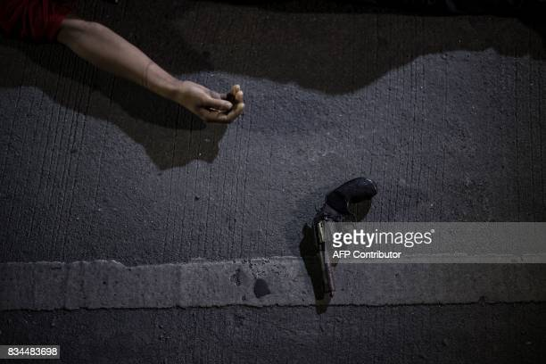 The body of an alleged drug dealer killed during a police antidrug operation is seen on the ground in Manila on August 18 2017 It's just after...