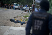 The body of an alleged gang member killed by the police after a shooting is seen at El Pedregal neighborhood in Tegucigalpa on November 21 2013...