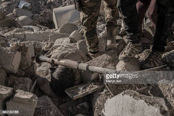 The body of an Islamic State fighter killed by Iraqi Counter Terrorism Service soldiers in Aden a suburb of Mosul An rocketpropelled grenade launcher...