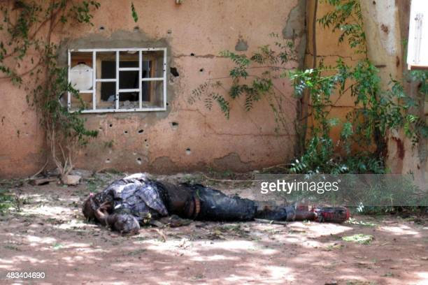 The body of an unidentified man lies outside the Hotel Byblos in the central Malian town of Sevare on August 8 after gunmen stormed the hotel on...